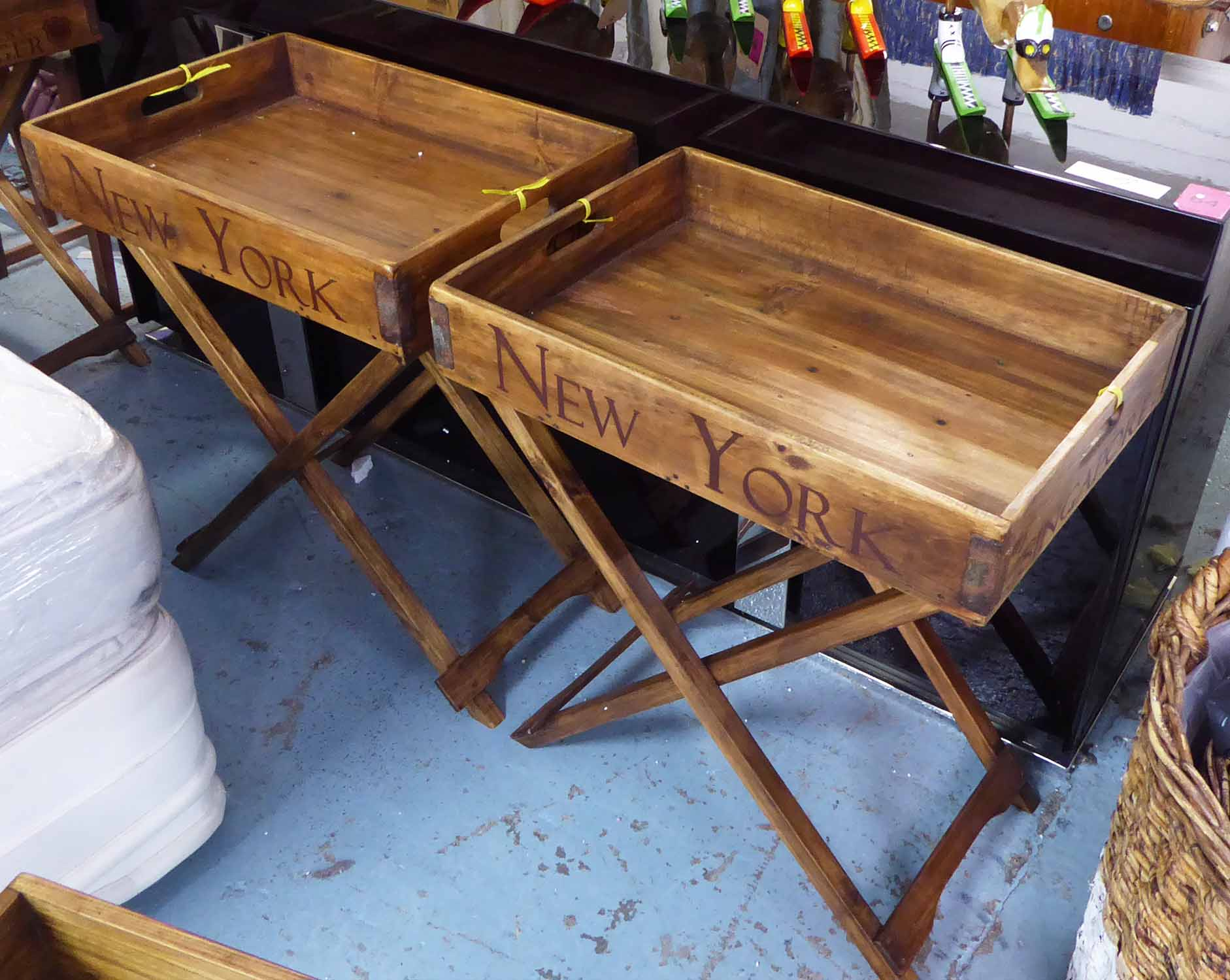 Lot 44 - BUTLERS TRAYS, a pair, on stands, stamped in vintage style typography with various city names,