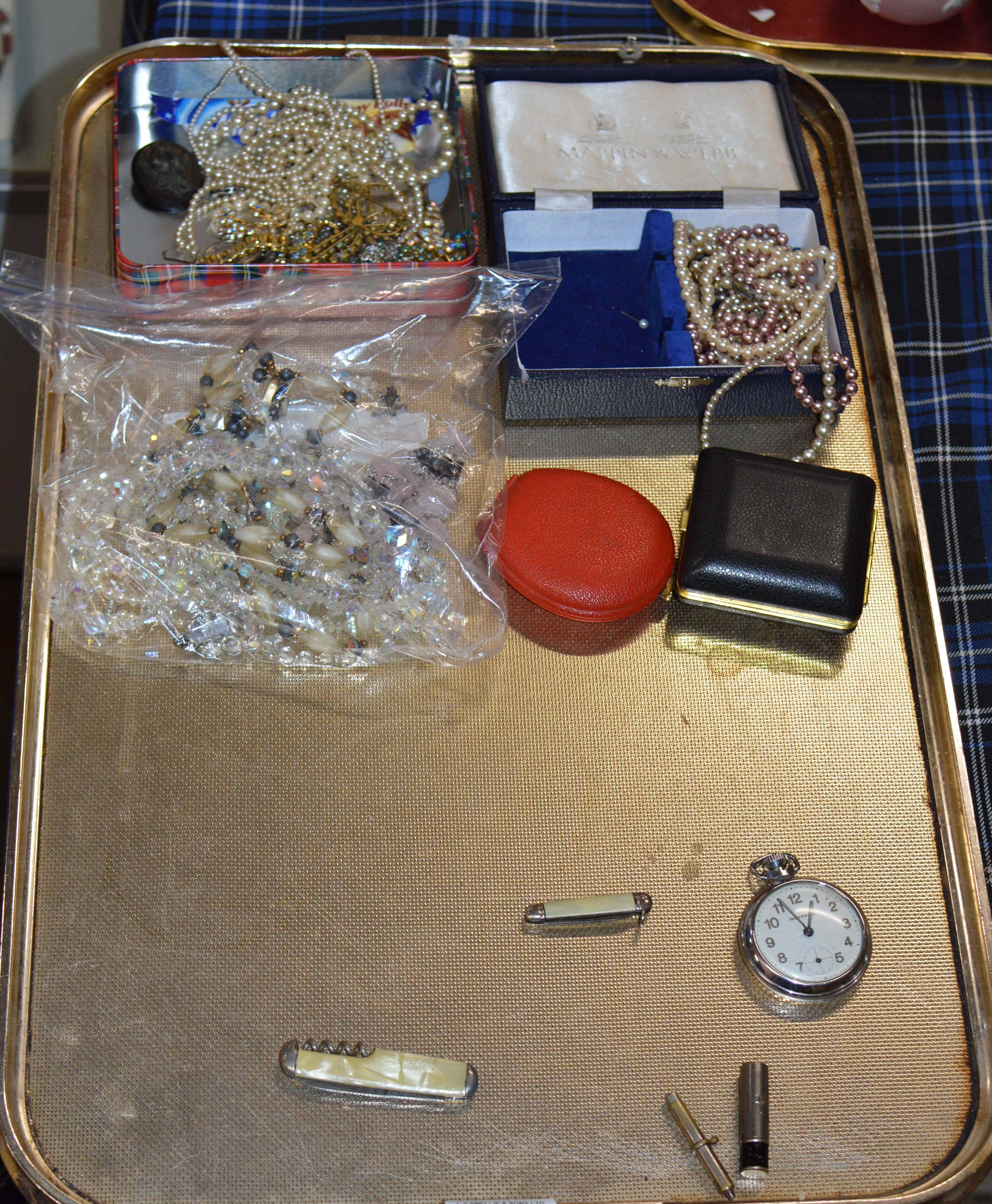 Lot 509 - TRAY CONTAINING VARIOUS COSTUME JEWELLERY, LAVA STYLE BROOCH, BEADS, TRAVEL CLOCKS, PEN KNIVES,