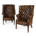 PAIR OF GEORGIAN STYLE BARREL-BACK LEATHER ARMCHAIRS20TH CENTURY the button-upholstered backs and