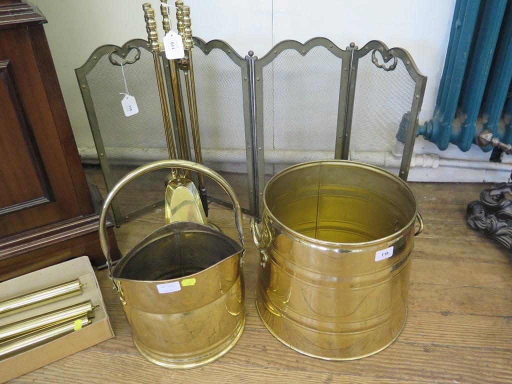 Lot 119 - A set of brass fire irons, a fire screen, a brass coal helmet, and a brass log basket