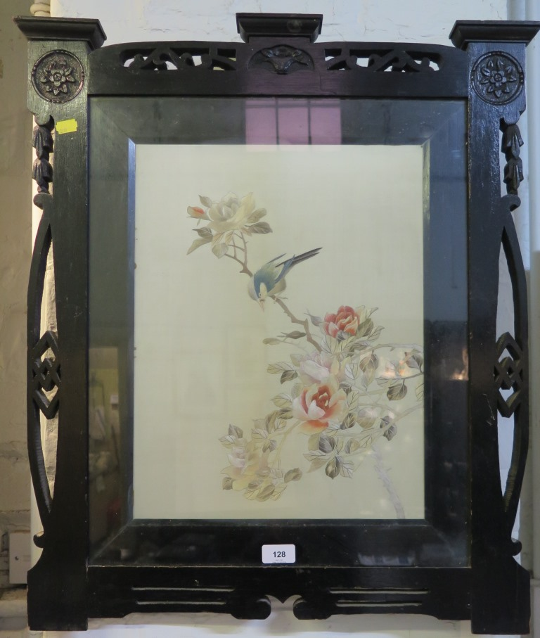 Lot 128 - An Edwardian ebonised fire screen containing a silk embroidered panel depicting a bird on a rose