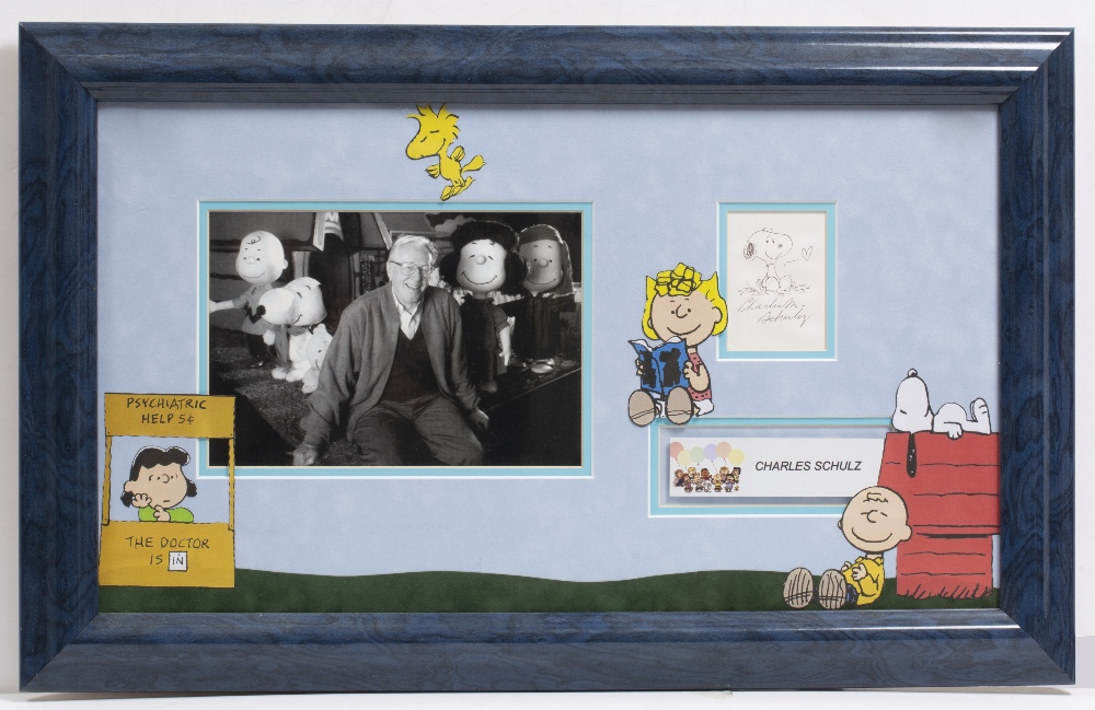 Lot 17 - CHARLES SCHULZ SIGNED SNOOPY CARTOON with a photograph of the Peanuts creator, mounted in a