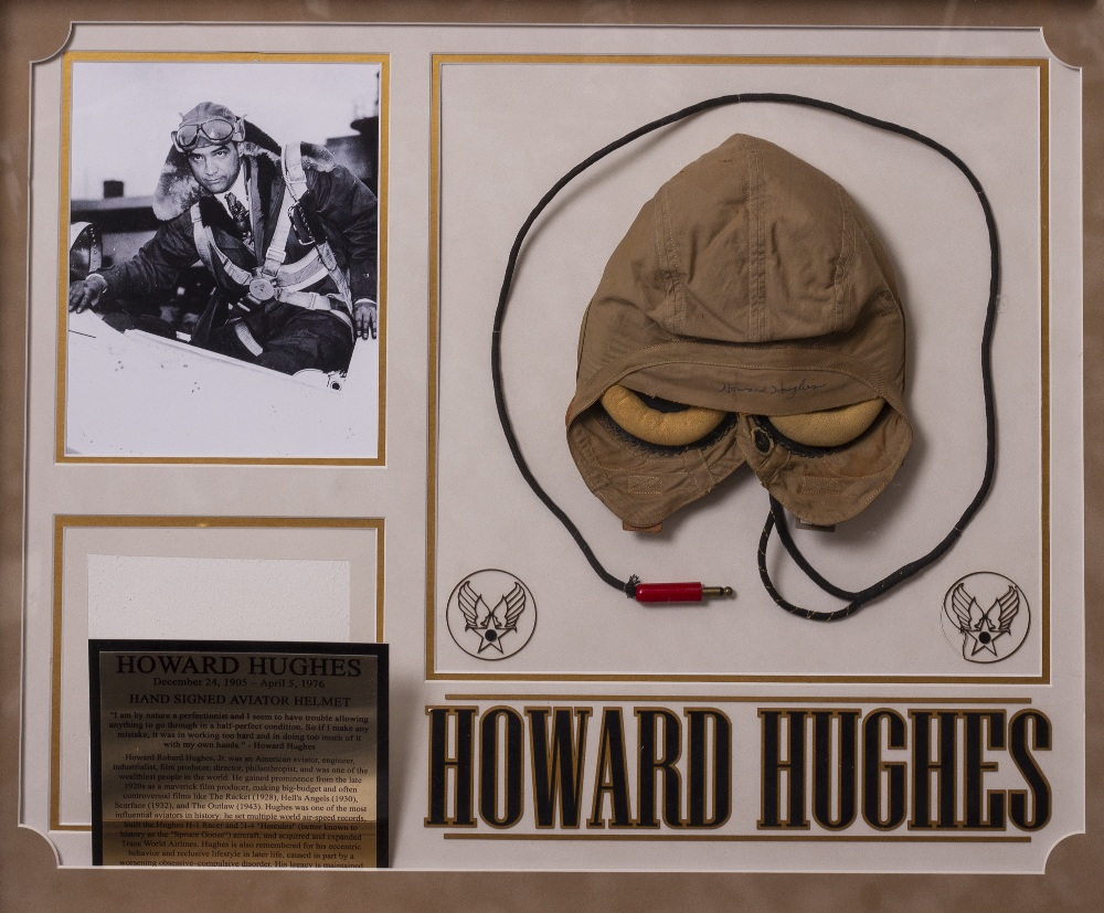 Lot 15 - A HOWARD HUGHES SIGNED AVIATOR'S FLIGHT CAP mounted in a display measuring 81cm x 67cm