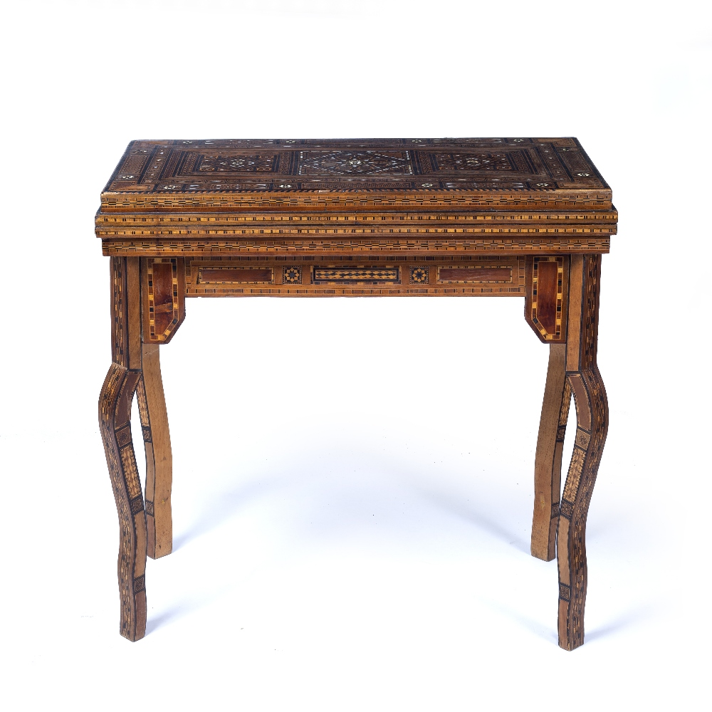 Lot 17 - Fold over games table Morocco with inlaid body and interior, the inside revealing similar inlaid