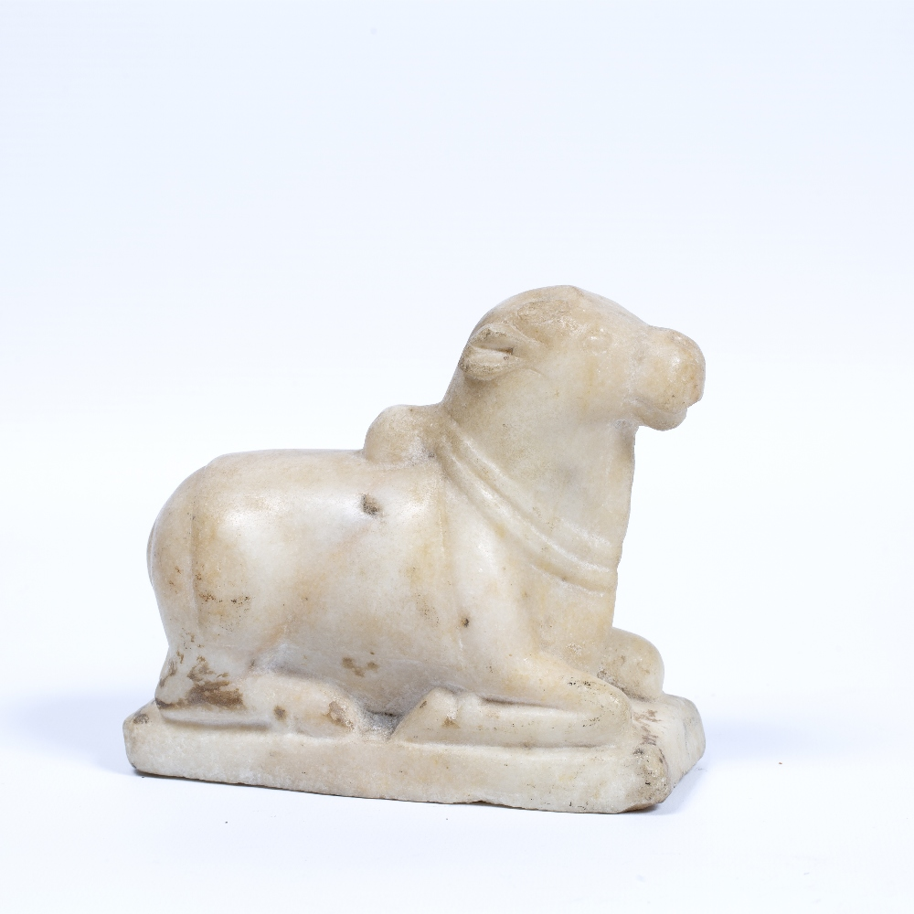 Lot 30 - Carved marble of an Ox India, 19th Century carved in a recumbent position 15cm across x 13.5cm high