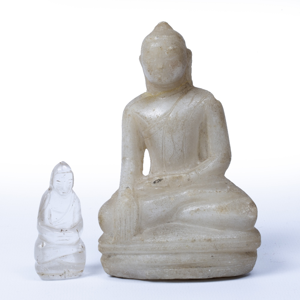 Lot 47 - Two carved Buddhas Thailand, 19th Century the largest carved in marble with one hand resting on