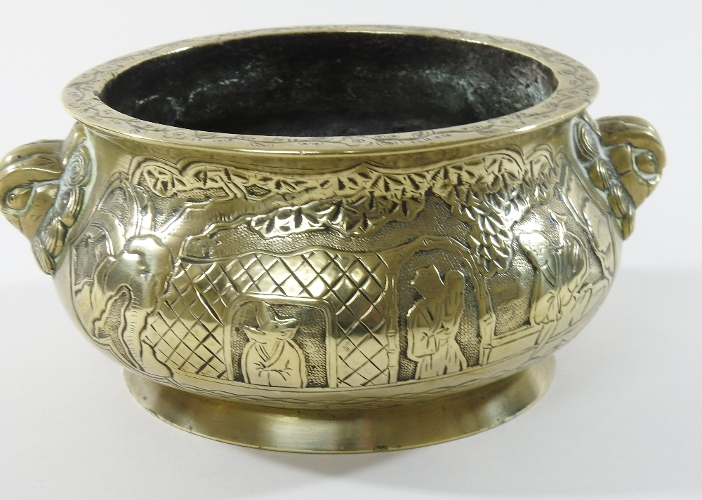 Lot 60 - A Chinese gilt bronze censer, decorated to either side with Oriental figures in a boat,