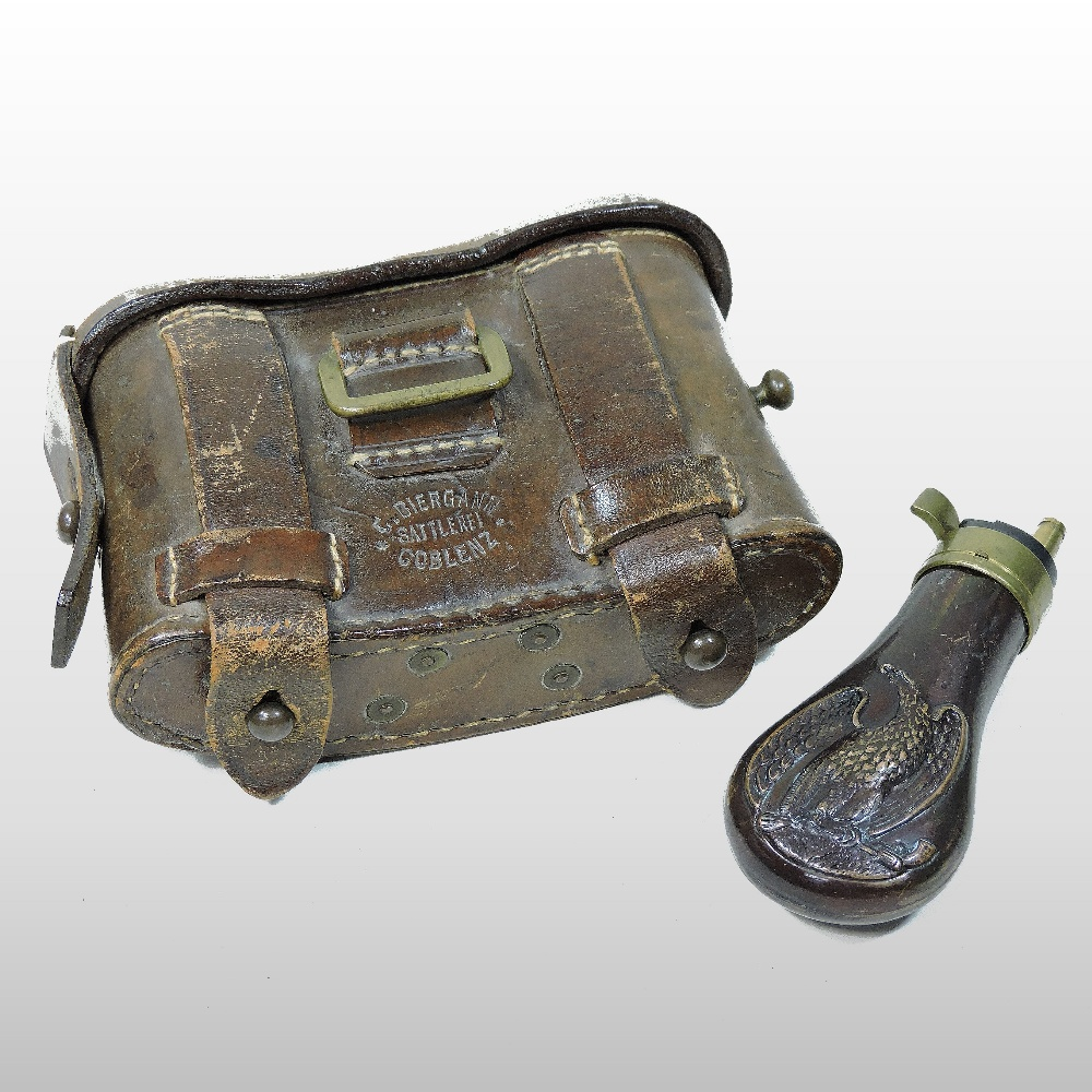 Lot 16 - An early 20th century German NCO officers leather ammunition pouch, stamped Coblenz,
