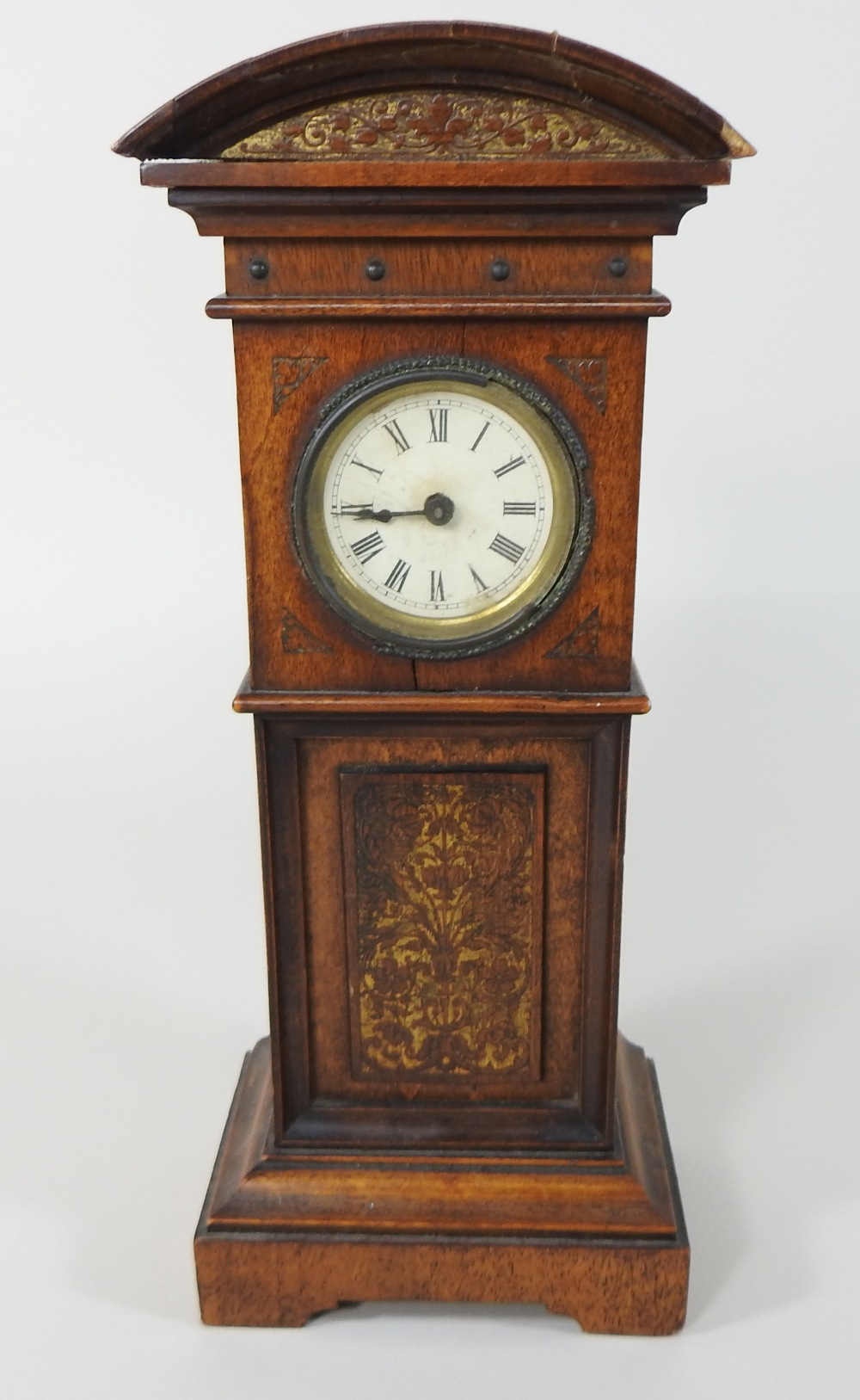 Lot 4 - A 19th century walnut cased miniature Grandfather clock, having a painted dial, with Roman hours,