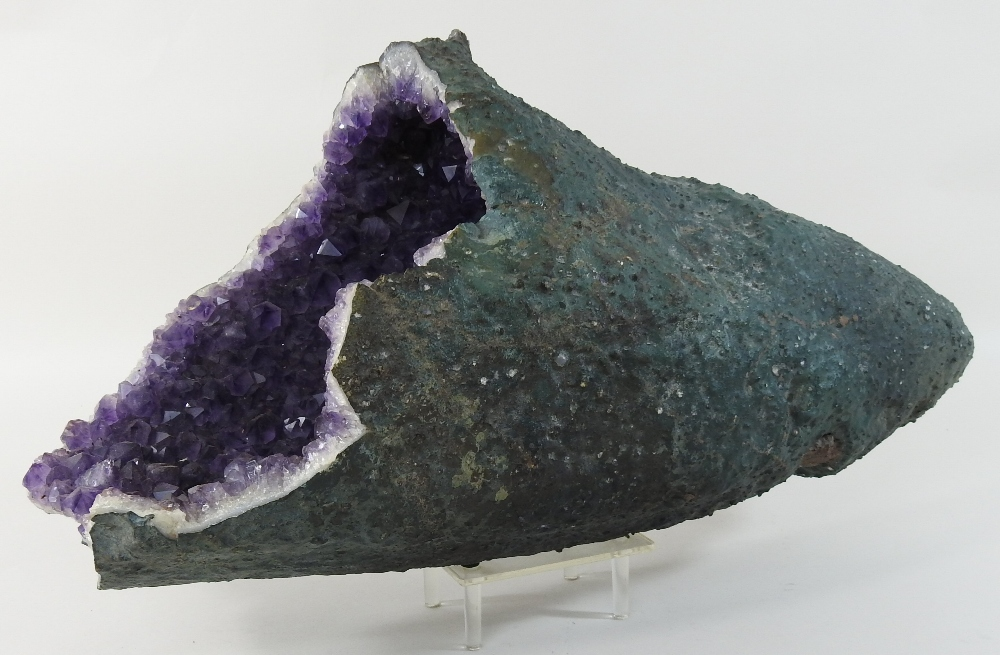 Lot 23 - A large natural amethyst, 51cm long,