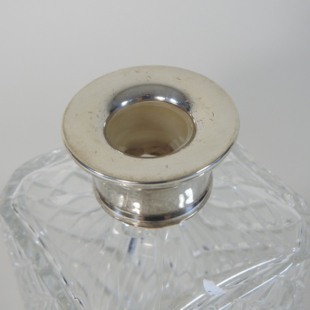 Lot 3 - A cut glass decanter and stopper, of square shape, with a silver collar, London 1973,