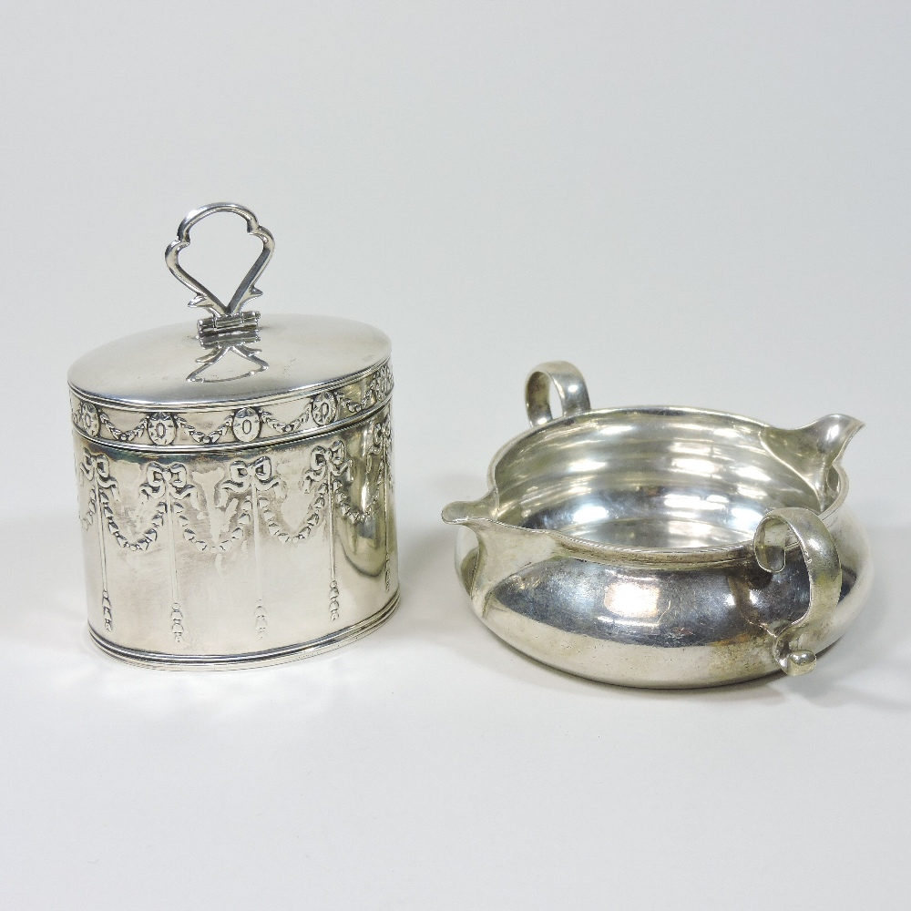 Lot 31 - An Edwardian silver box and cover, in the form of a miniature Georgian tea caddy,