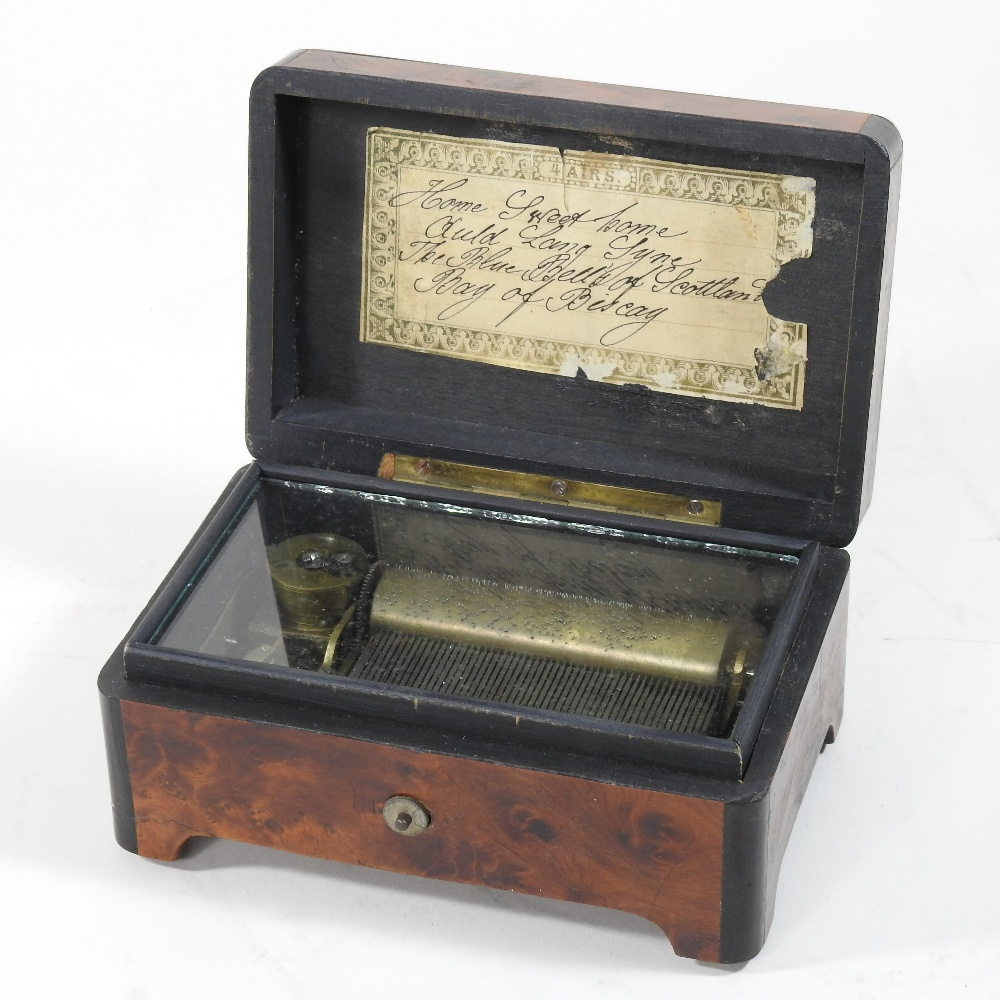 Lot 49 - A 19th century miniature musical box, in a brass mounted walnut and ebonised case,