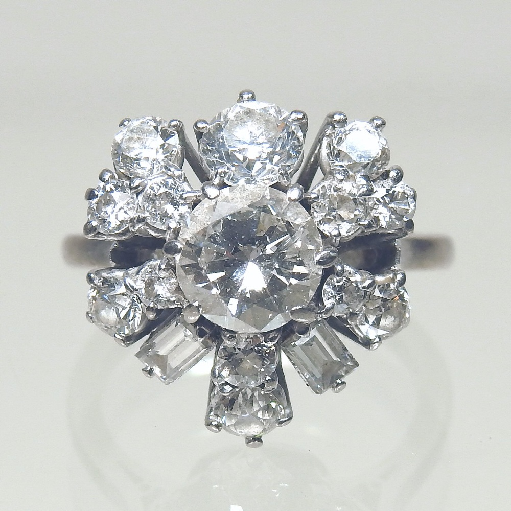 Lot 21 - Withdrawn - A large bespoke made unmarked platinum and diamond cluster ring,