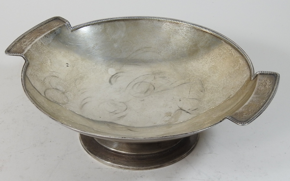Lot 26 - An early 20th century silver twin handled fruit bowl, of circular pedestal shape, with a beaded rim,