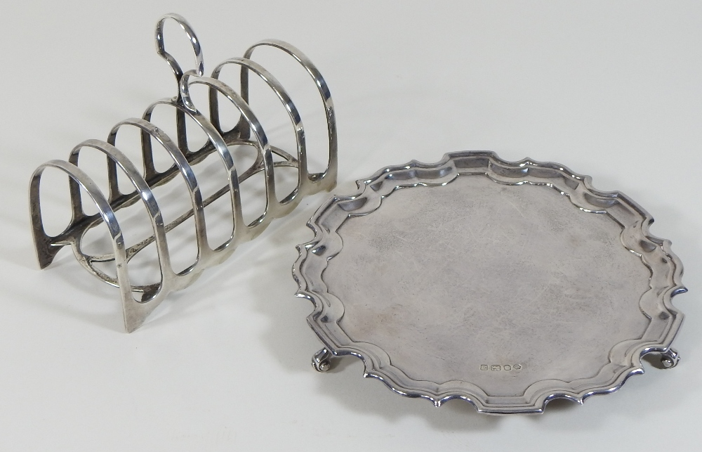 Lot 2 - A modern silver waiter, of circular shape, with a piecrust border, on three scrolled feet,