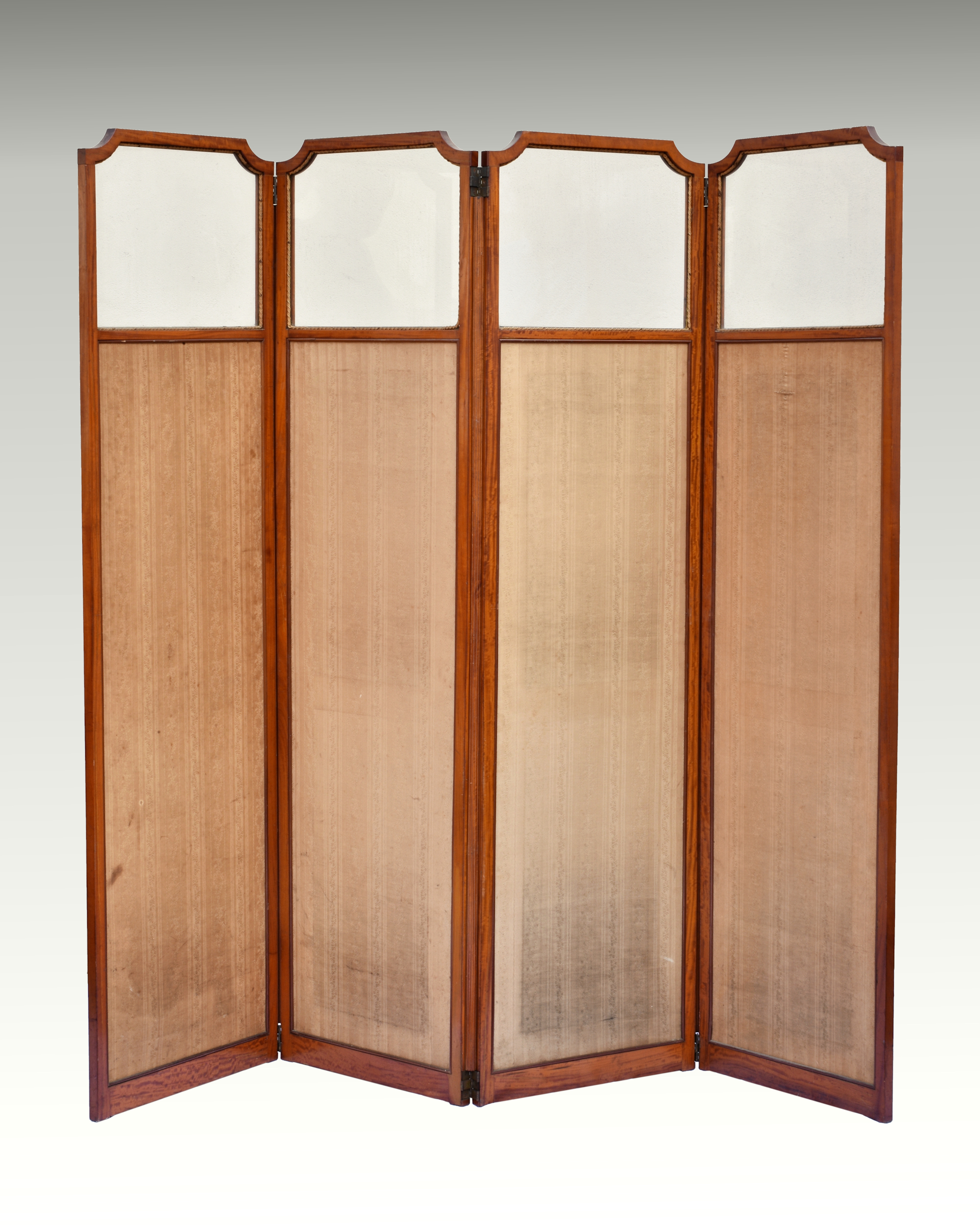 Lot 621 - A good quality 19th century solid satinwood four fold dressing screen the glazed top with incuse
