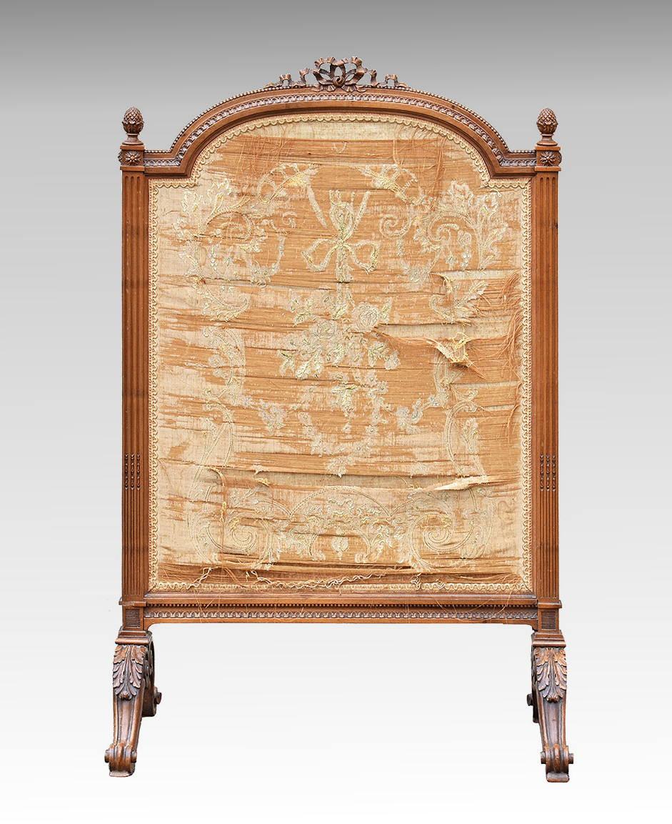 Lot 638 - A French carved walnut firescreen c.1900, in the Louis XVI style, the broken arch screen with