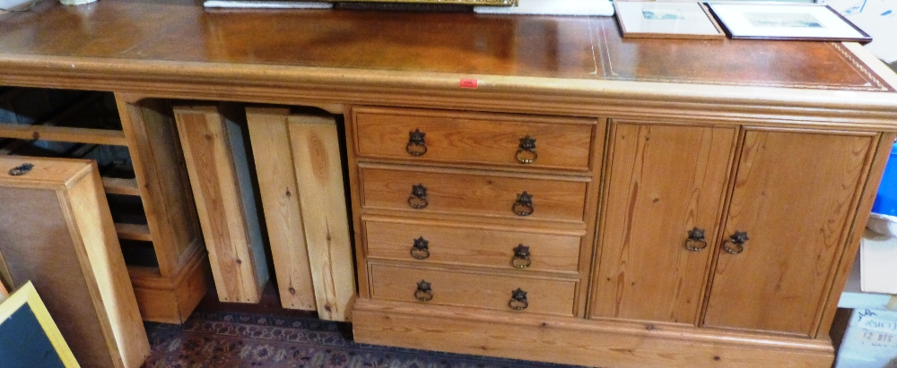 Lot 192 - A pine desk of recent manufacture, the leather inlet top over a kneehole, two flights of four