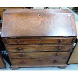 Lot 256 - A George III elm bureau, the sloping fall over four long drawers. 40' wide