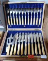 Lot 44 - An oak canteen of fish cutlery