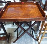 Lot 218 - A 19th century mahogany butler's serving tray on folding stand. 24' wide