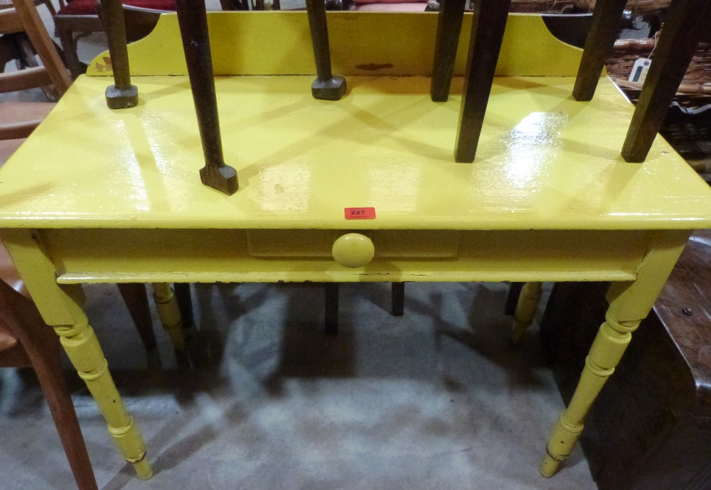 Lot 227 - A Victorian painted pine side table on turned legs. 38' wide
