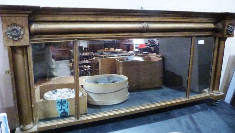 Lot 249 - A Regency giltwood and gesso overmantle with triple plate and columnar surround. 53' wide