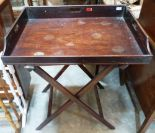 Lot 220 - A 19th century mahogany butler's tray on folding stand. 30' wide