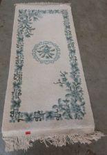 Lot 191 - An Indian wool cream ground rug