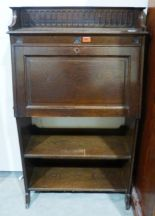 Lot 261 - An Arts and Crafts style oak student's bureau. 29' wide