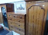 Lot 262 - A Victorian pitch pine triple wardrobe, the centre part a chest of five short over two long and