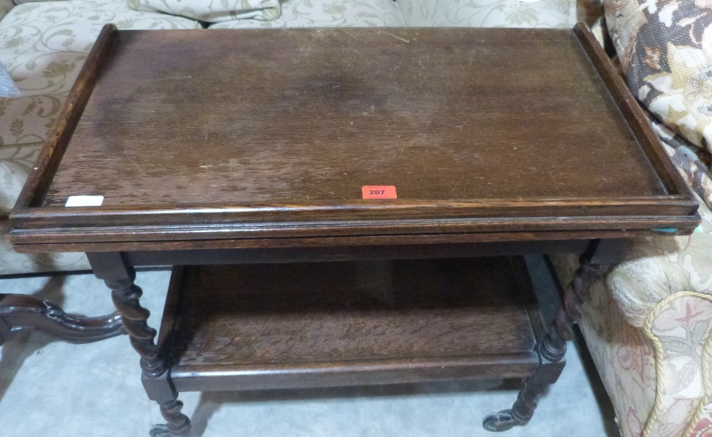 Lot 207 - A 1920s oak barleytwist two tier tea trolley/card table with distressed green baize fold-over top