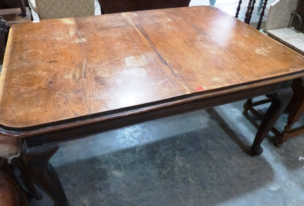 Lot 240 - A Victorian oak dining table on cabriole legs. 60' long