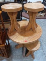 Lot 225 - A small elm table with four stools