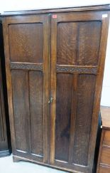 Lot 194 - A 1930s 'An-Lyn' oak compactum style wardrobe with camphor lined fully fitted interior. 40' wide