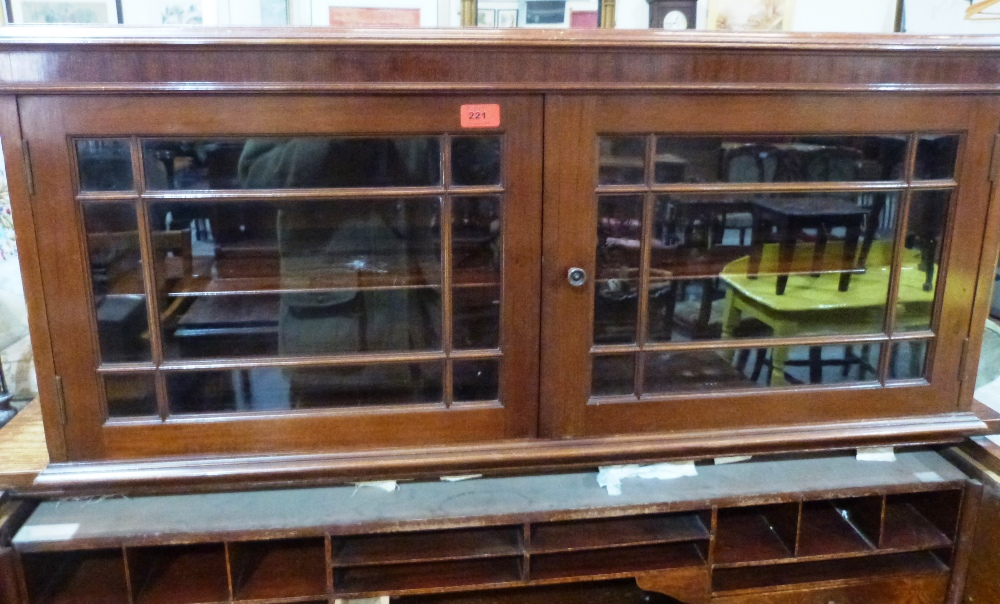 Lot 221 - A Victorian mahogany dwarf bookcase enclosed by a pair of astragal glazed doors. 42' wide