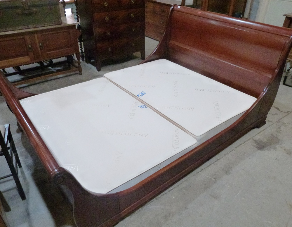 Lot 231 - A 4'6' mahogany sleigh bedstead by AND SO TO BED, LONDON