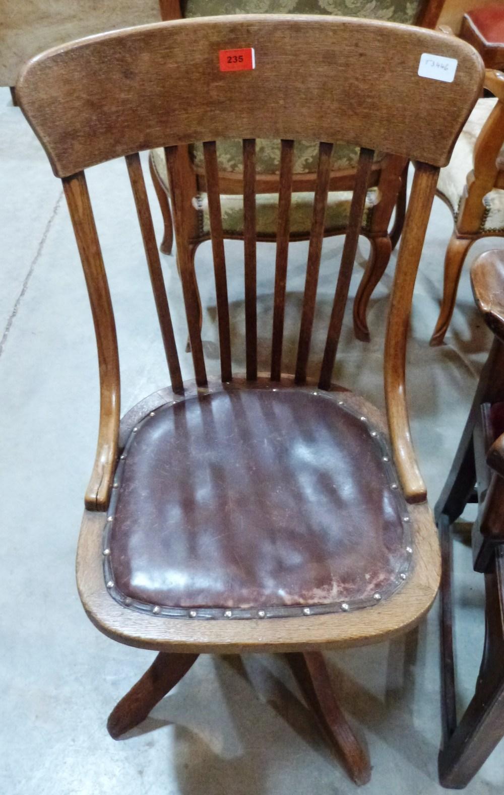 Lot 235 - A 1920s oak revolving office chair