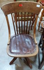 Lot 235 - A 1920s oak revolving office chair