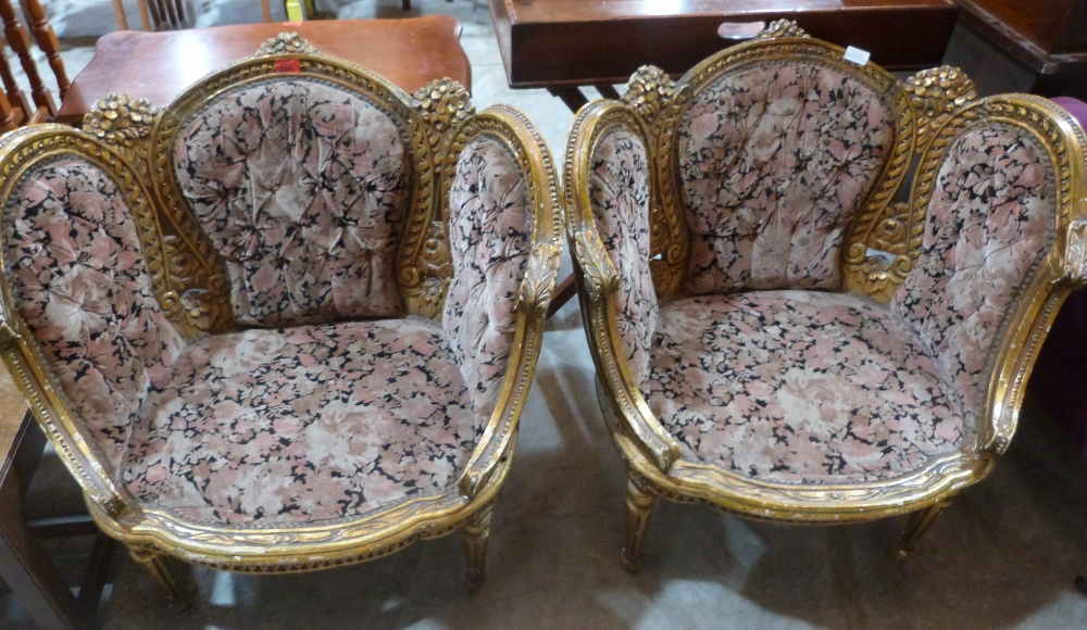 Lot 211 - A pair of 19th century French giltwood and gesso salon chairs