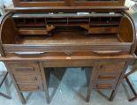 Lot 222 - A 1930s oak roll-top desk. Tambour slick A.F. 48' wide