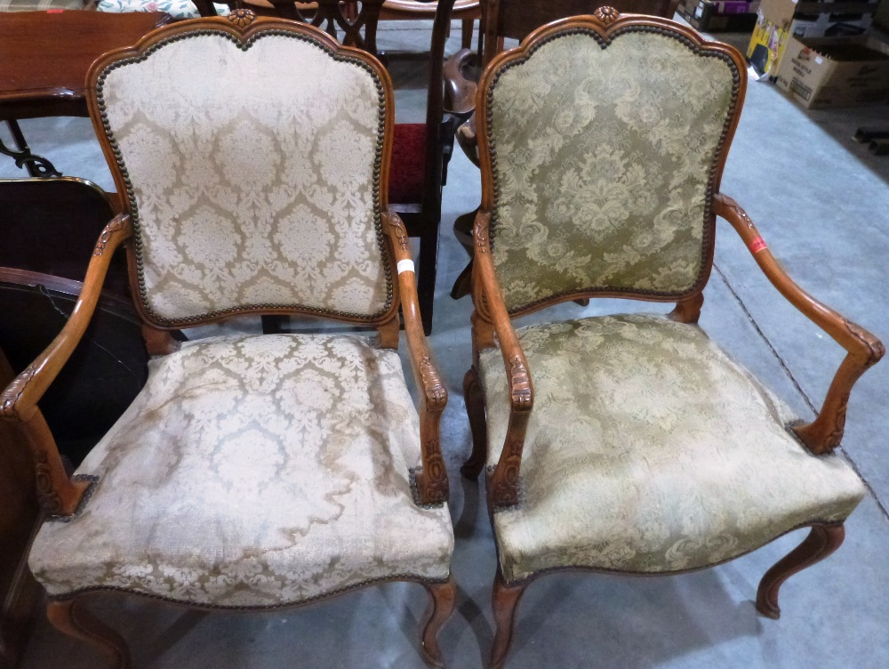 Lot 248 - A pair of French elbow chairs