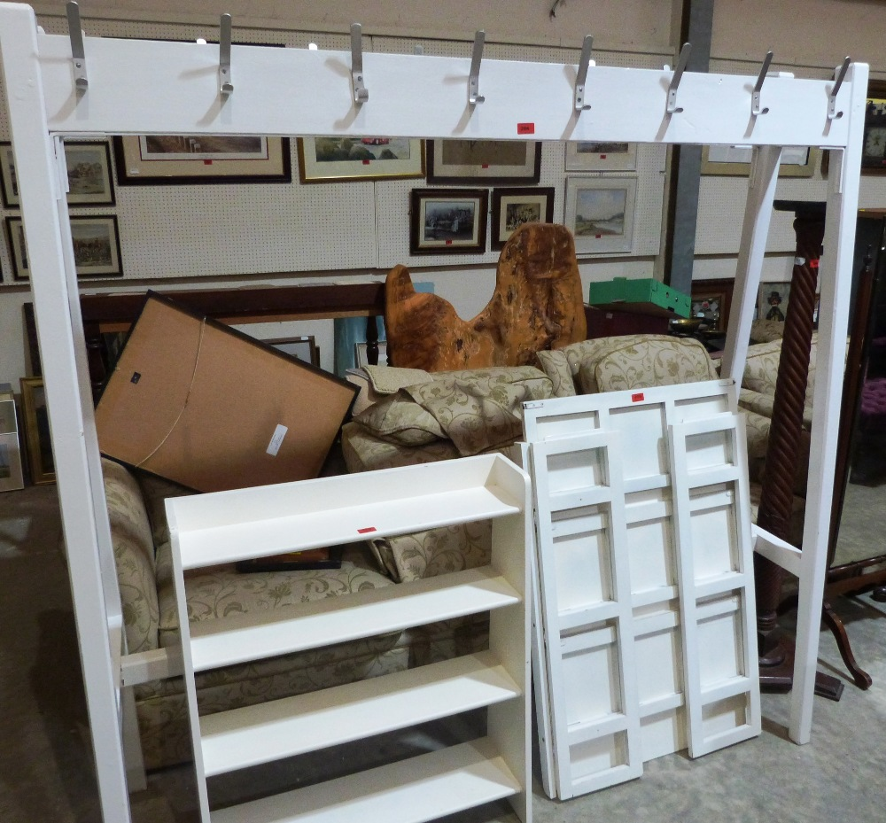 Lot 204 - A painted school coat rack 72' wide, folding shelves and a bookcase