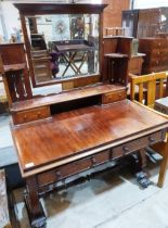 Lot 229 - A William IV mahogany sofa table on lyre end standard support with volute feet. The top with later
