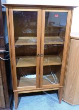 Lot 259 - A pine veneered display cabinet on stand. 35' wide