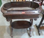 Lot 216 - A Victorian rosewood jardiniere table on lyre end supports united by an undertier. 27' wide