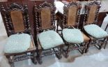 Lot 245 - A set of four oak Carolean style chairs with caned backs and seats