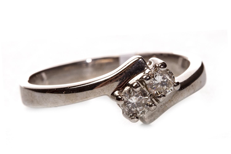 Lot 128 - A DIAMOND TWO STONE RING