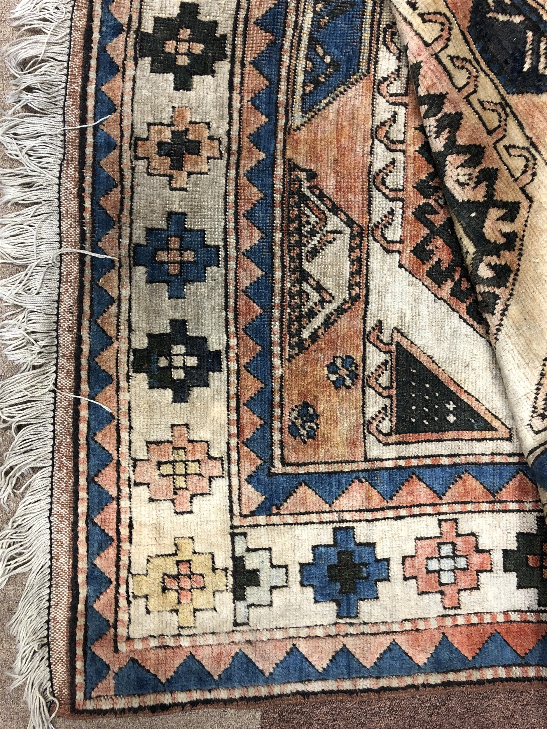 Lot 1075 - A MIDDLE EASTERN FRINGED CARPET